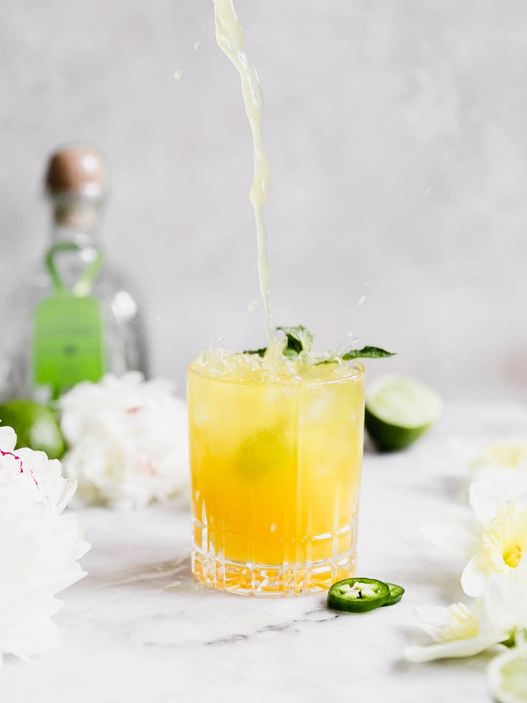 A ridiculously refreshing Spicy Passionfruit Margarita made with a homemade spicy passionfruit syrup, orange liqueur, and tequila