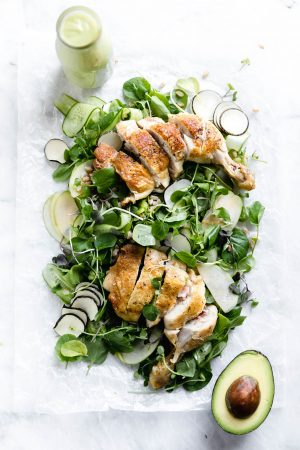 """A loaded green chicken salad with watercress, green apples, farro, and a """"creamy"""" dairy-free avocado dressing! So perfect for summer entertaining."""