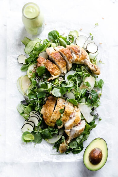 A loaded green chicken salad with watercress, green apples, farro, and a
