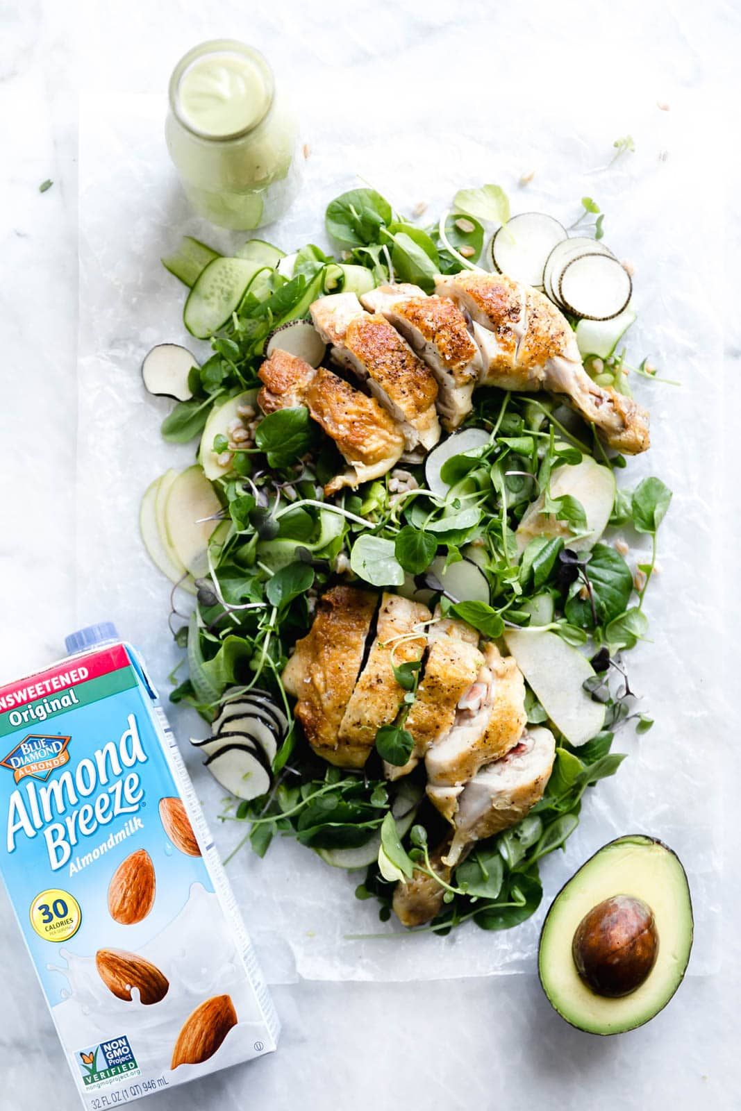"A loaded green chicken salad with watercress, green apples, farro, and a ""creamy"" dairy-free avocado dressing! So perfect for summer entertaining."