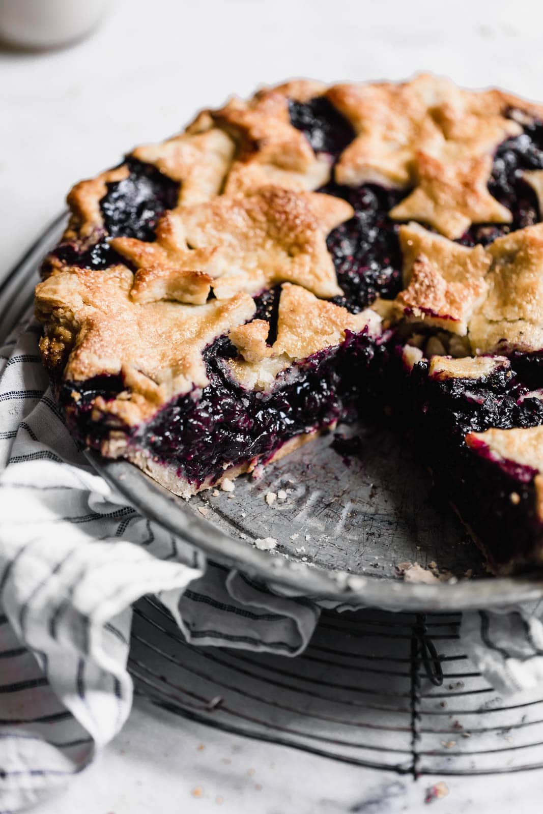 blueberry pie with slice missing