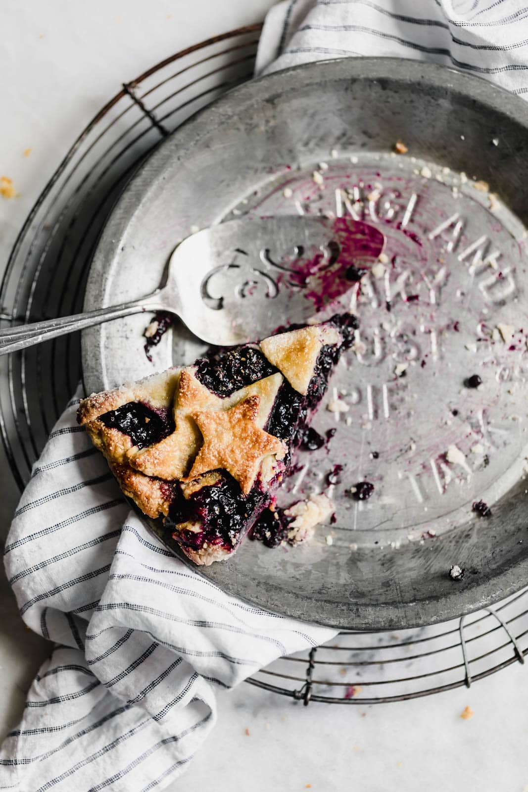 slice of blueberry pie in a pie pan