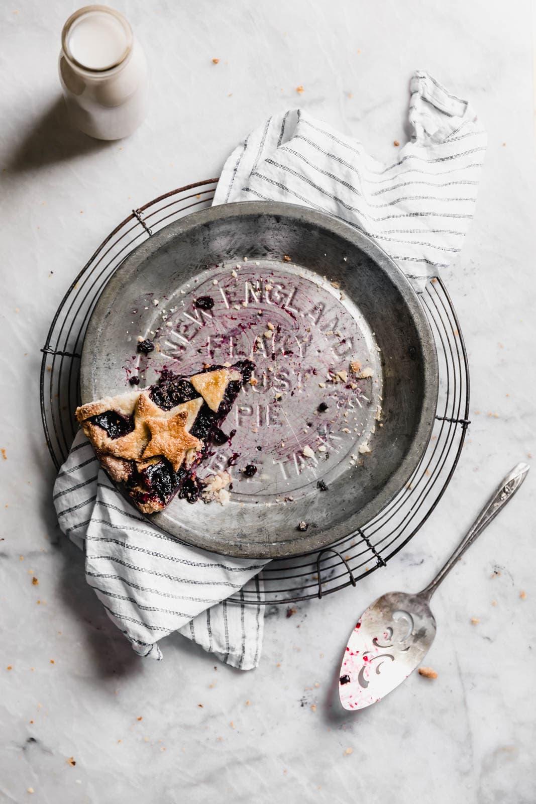 fresh blueberry pie slice in empty pie pan