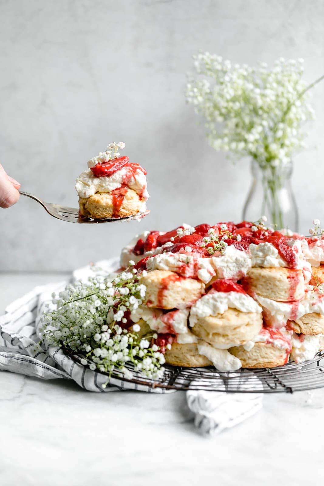 serving a slice of strawberry shortcake cake