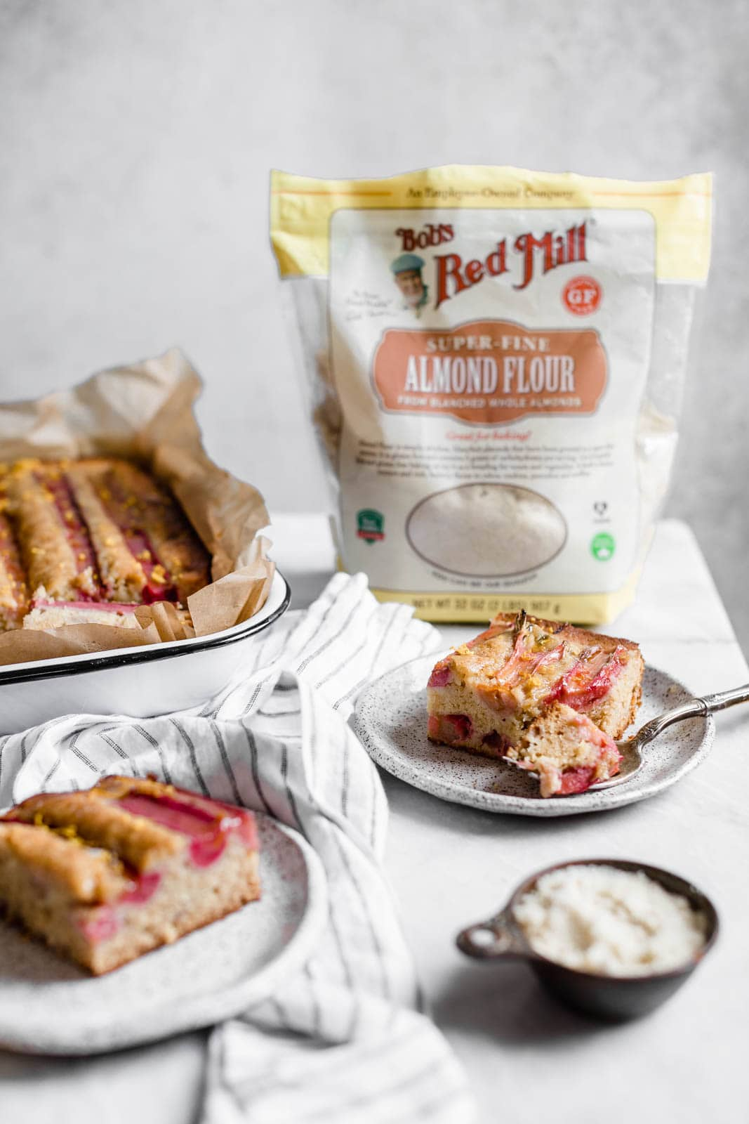A rustic rhubarb almond honey cake with a hint of orange zest and wildflower honey. A perfect one-bowl snack cake ready in just 45 minutes!