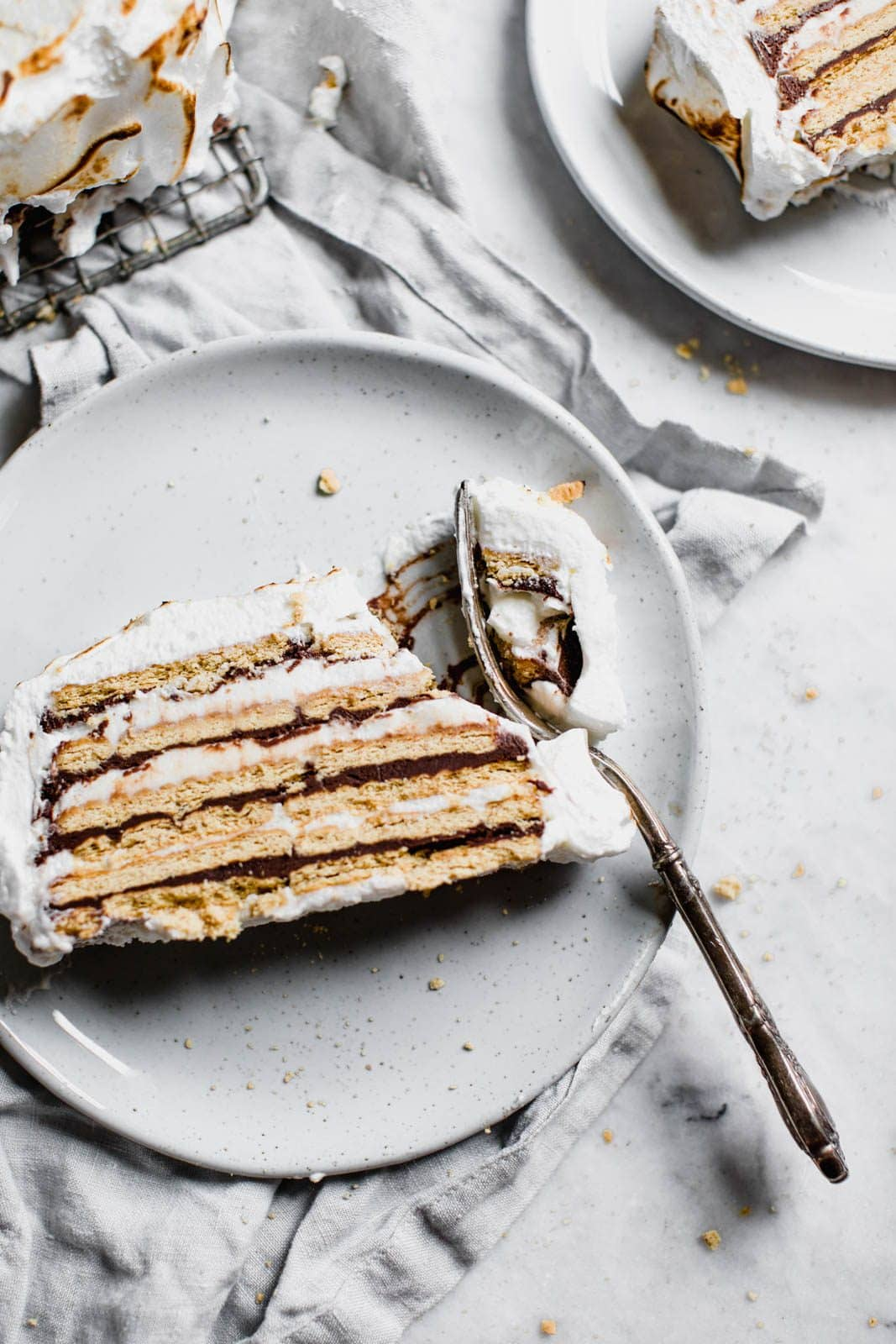 s'mores ice box cake on a plate with fork