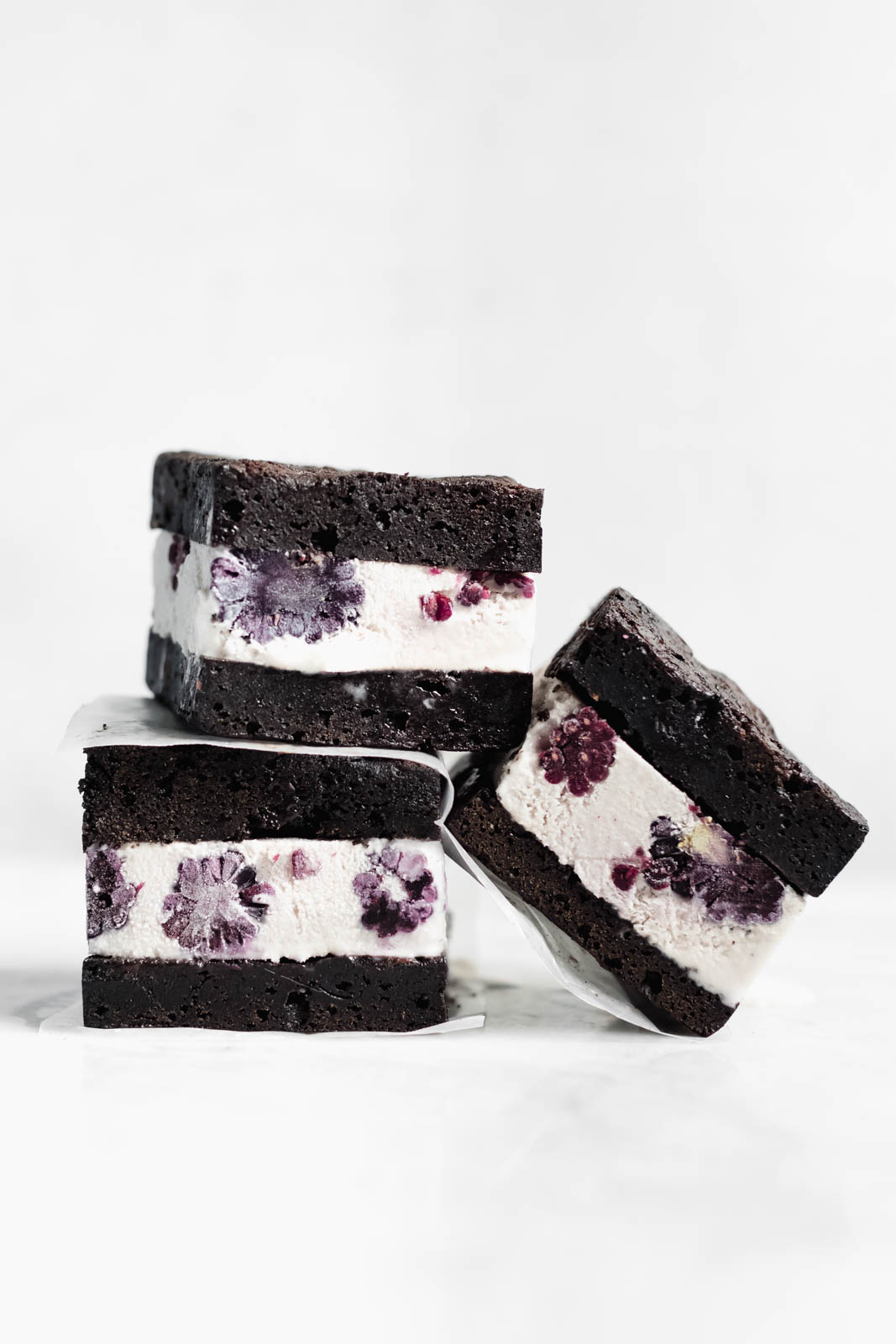 Brownie Ice Cream Sandwiches are the new thing. Made with boxed brownies and store-bought vanilla ice cream mixed with blackberry purée!