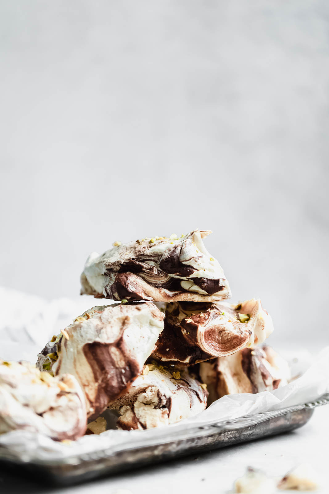 The easiest chocolate swirled spoon meringues that you literally spoon onto a baking sheet. Top 'em with crumbled pistachios, bake, and done!
