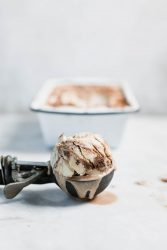 A creamy, dreamy vegan peanut butter ice cream made with coconut cream and swirled with chocolate ganache and graham crackers!