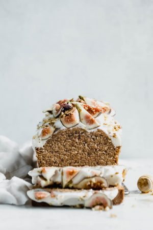 A beautifully simple one bowl honey cake spiced with cinnamon, orange, and black tea, and topped with fresh figs and a goat cheese frosting!