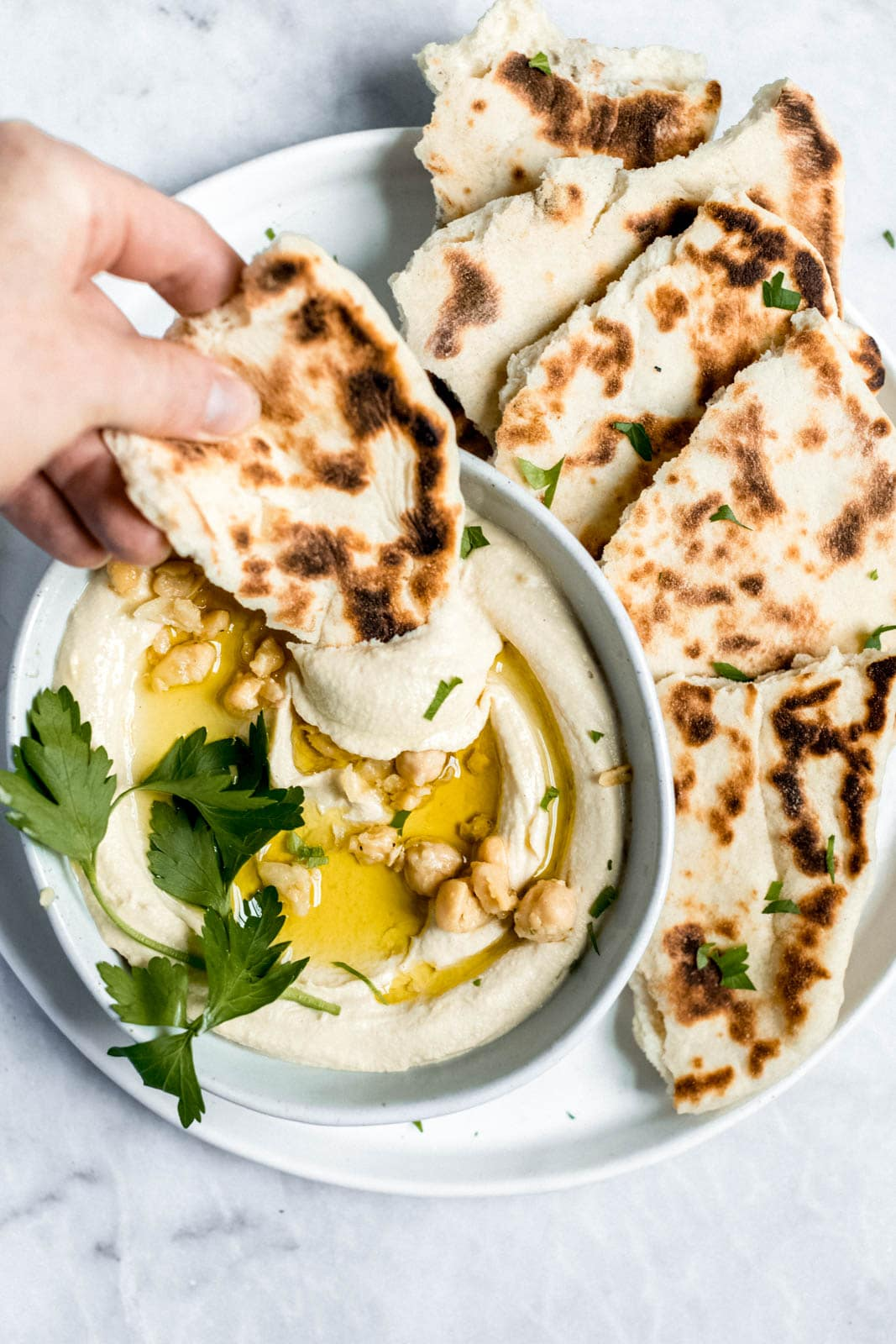 pita bread with hummus drizzled with olive oil