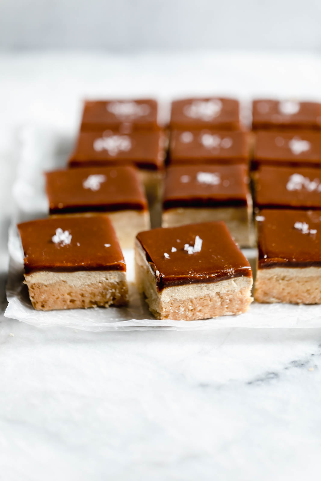 """A buttery shortbread topped with a halva """"nougat"""" and tahini caramel, this Middle Eastern Millionaire's Shortbread is sinfully delicious!"""