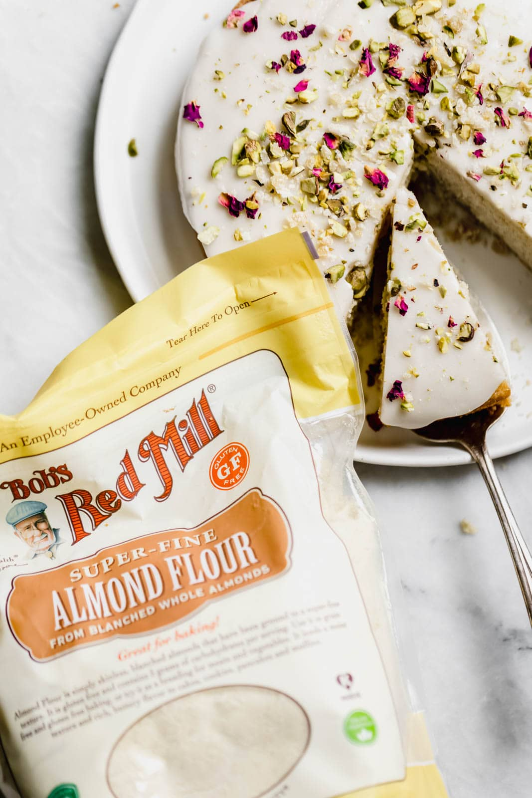 almond and rose cake next to a bag of almond flour