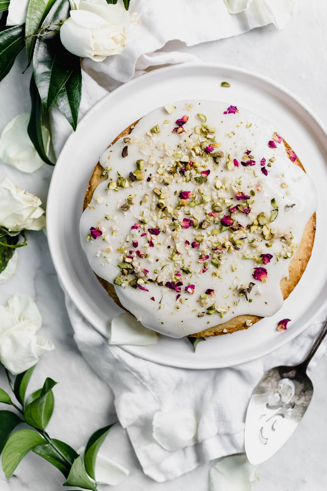 Persian Love Cake: a fragrant cake flavored with freshly ground cardamom, rose water, and almond flour, and topped with crushed pistachios and rose petals.