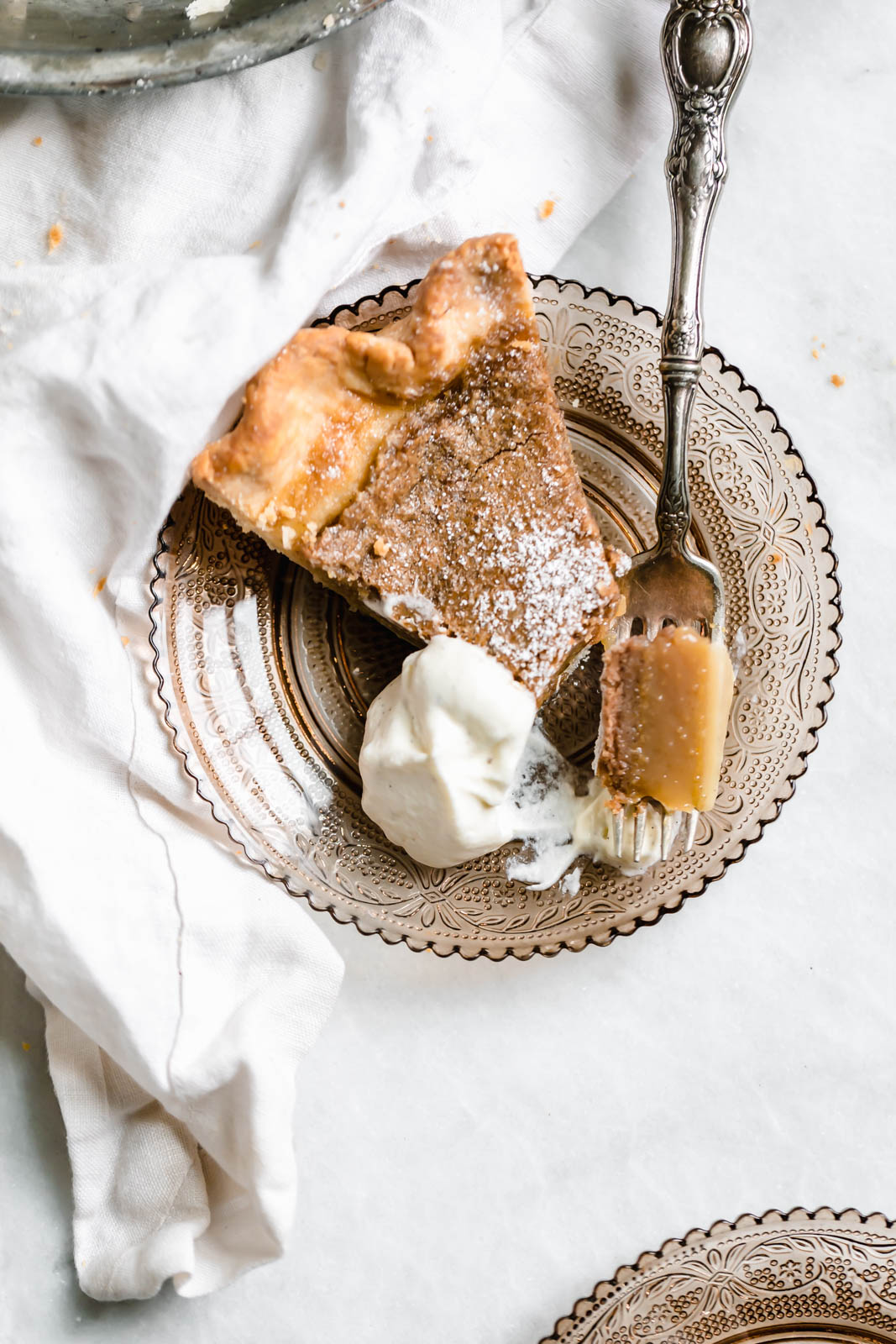 slice of Brown Butter Maple Chess Pie with whipped cream