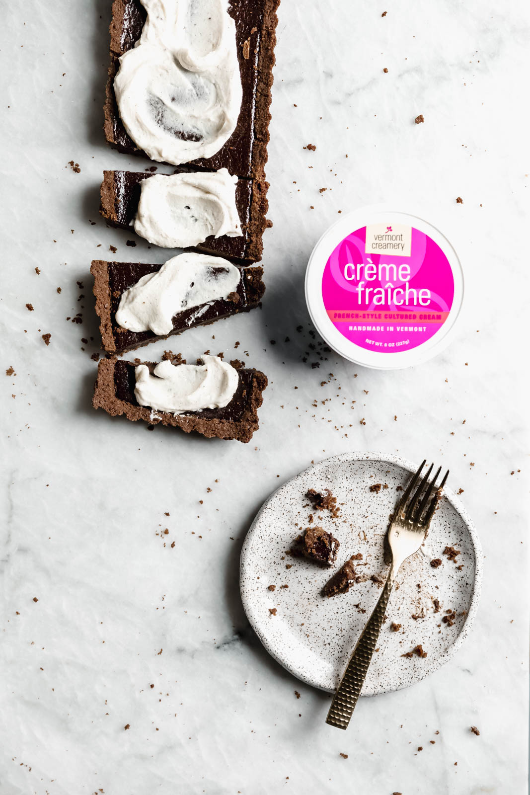 A Mocha Chocolate Tart made with a chocolate graham cracker crust, rich mocha filling, and topped with a crème fraîche whipped cream!