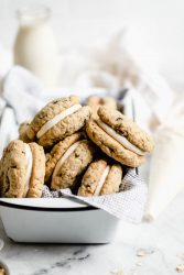 Easy to whip up on a weeknight, these chewy oatmeal whoopie pies are made with homemade oatmeal raisin cookies and a luxurious cream cheese frosting.