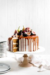 One bite of this Pumpkin Cake and you'll never want another cake ever again. Topped with the best cream cheese frosting and a salted caramel drizzle.