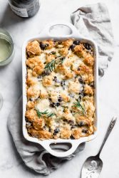 Savory Rosemary Olive Bread Pudding made with a rustic country loaf and loaded with cheesy goodness. A perfect alternative to stuffing at thanksgiving!
