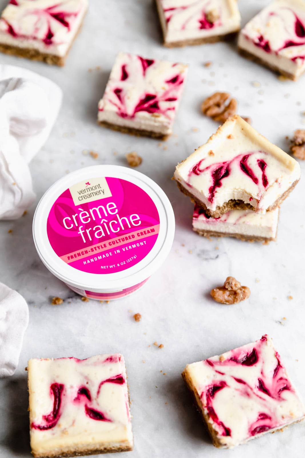 Walnut Cranberry Cheesecake Bars with container of creme fraiche