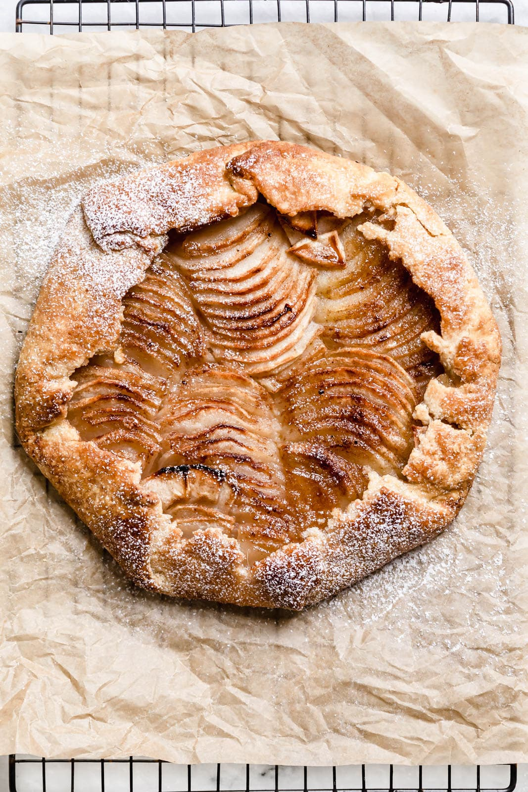 Cinnamon Apple Galette on parchment paper