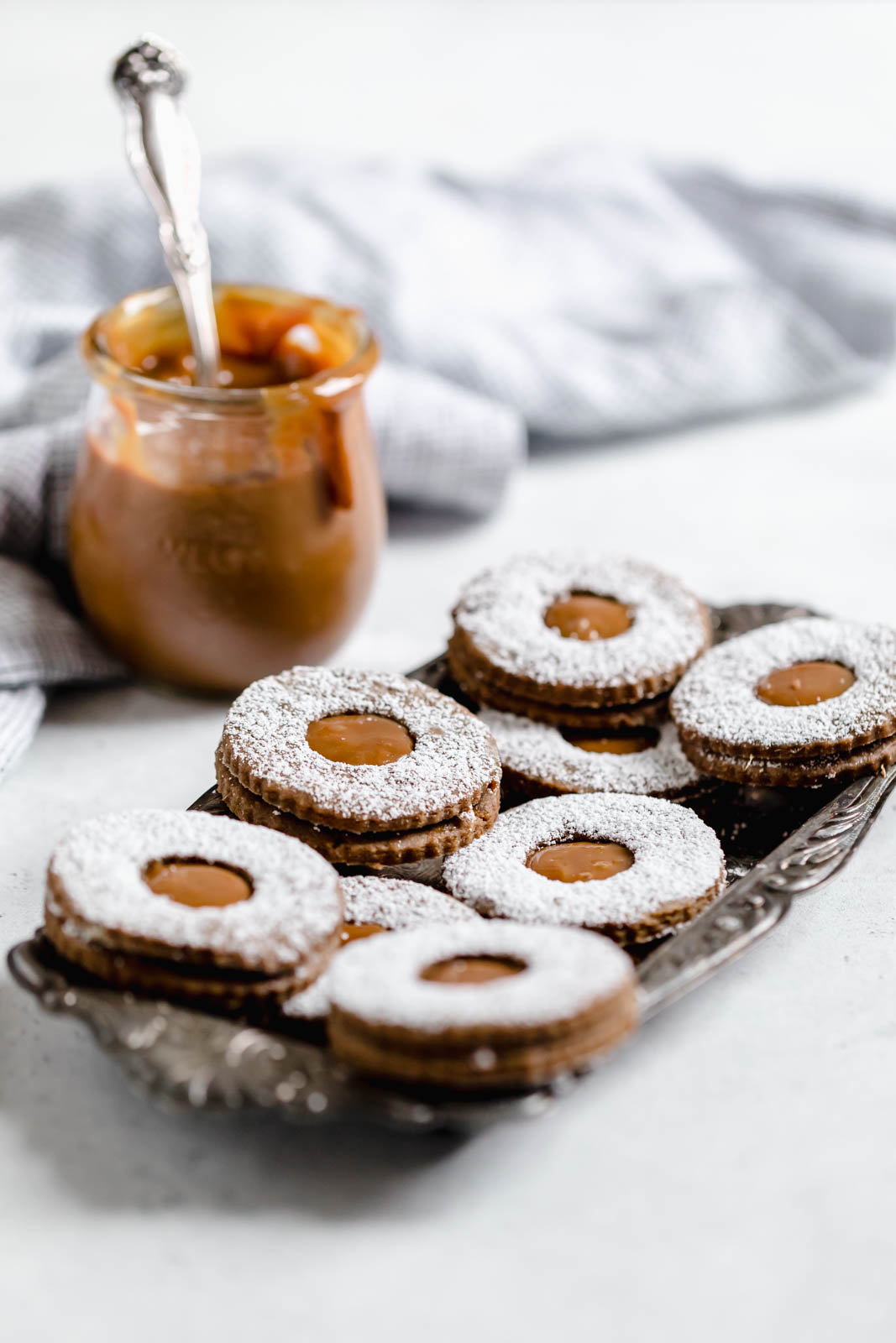 Gingerbread Linzer Cookies on a metal tray