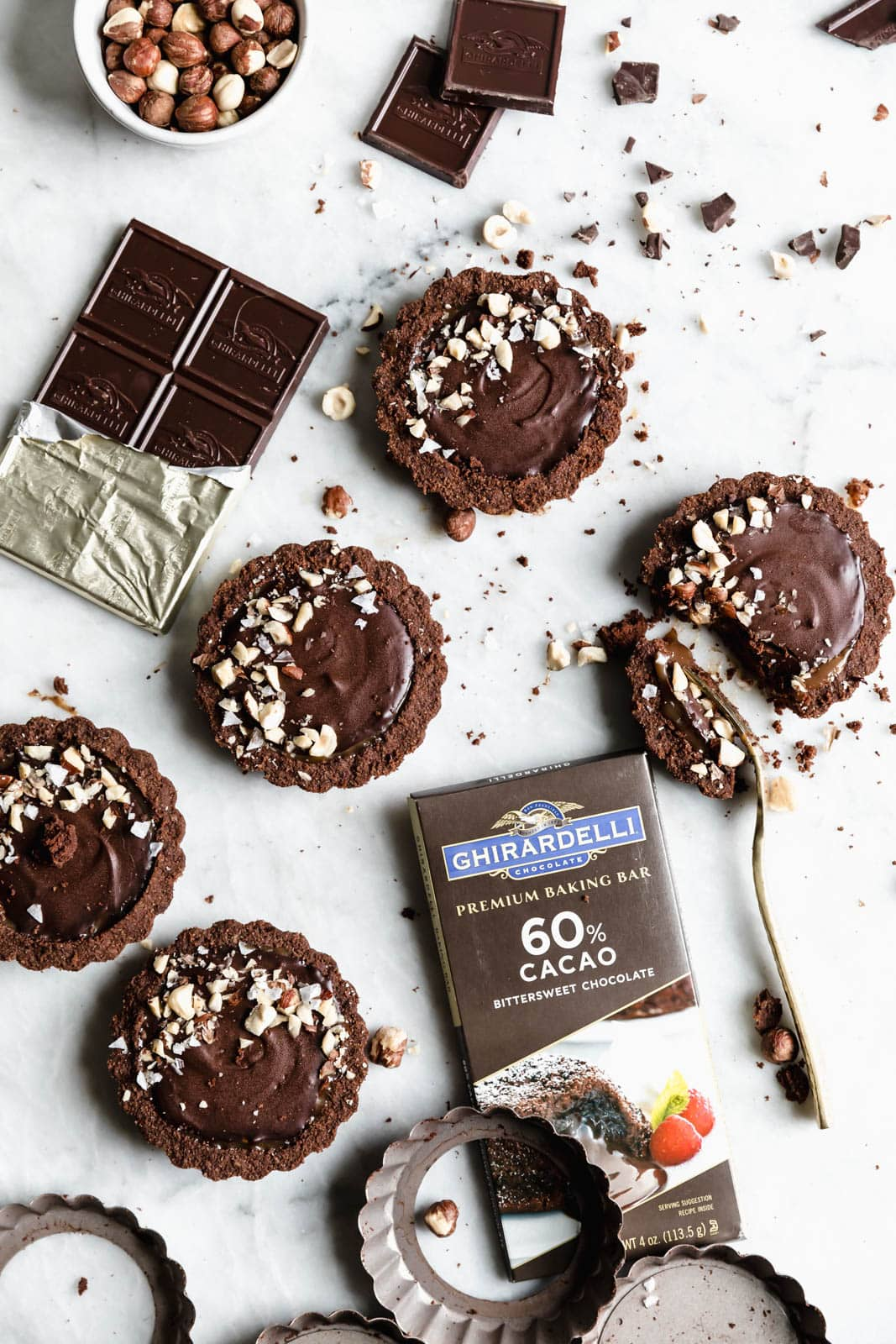 I've never met a tart I didn't like, but these Salted Caramel Chocolate Tarts with a chocolate graham crust and toasted hazelnuts are on another level.