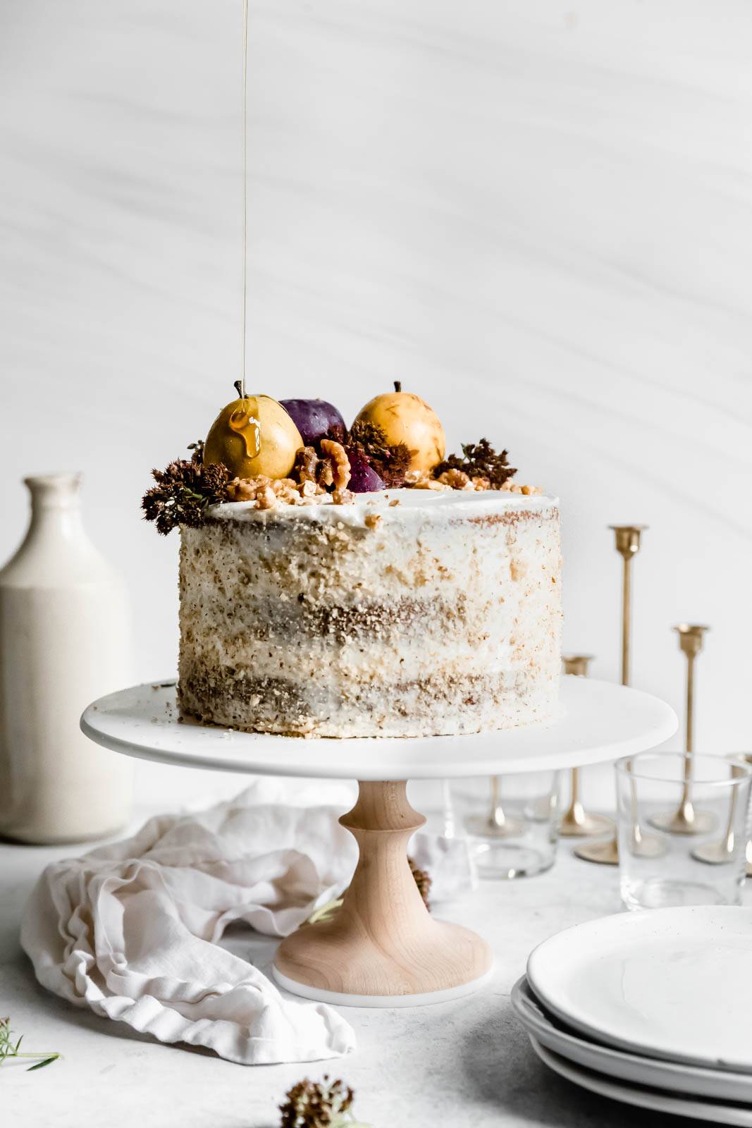 Maple Walnut Cake with Maple Frosting on a cake stand