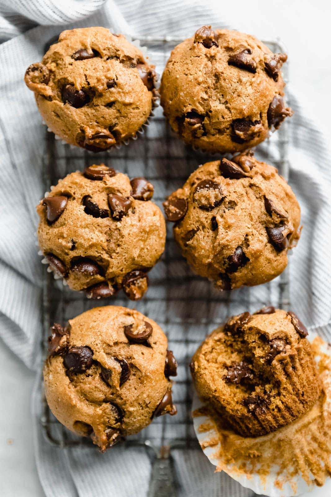 Absurdly moist Pumpkin Chocolate Chip Muffins made with cinnamon, nutmeg, ginger, and giant chocolate chips! Bonus: freeze them for an easy weekday treat!