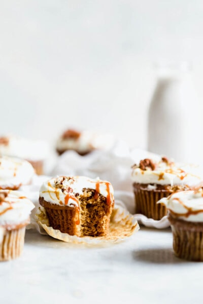The perfect winter cupcake is here! Sweet potato cupcakes flavored with cinnamon and ginger and topped with a tangy cream cheese frosting.