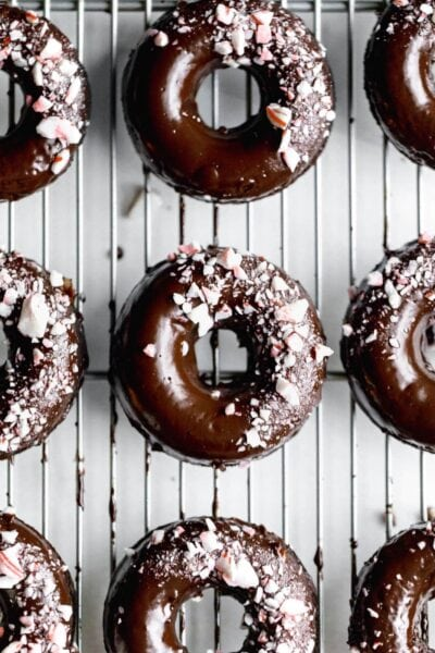 Ultra moist dairy-free and grain-free baked Peppermint Chocolate Donuts made topped with a dark chocolate ganache and candied peppermints. NOM.