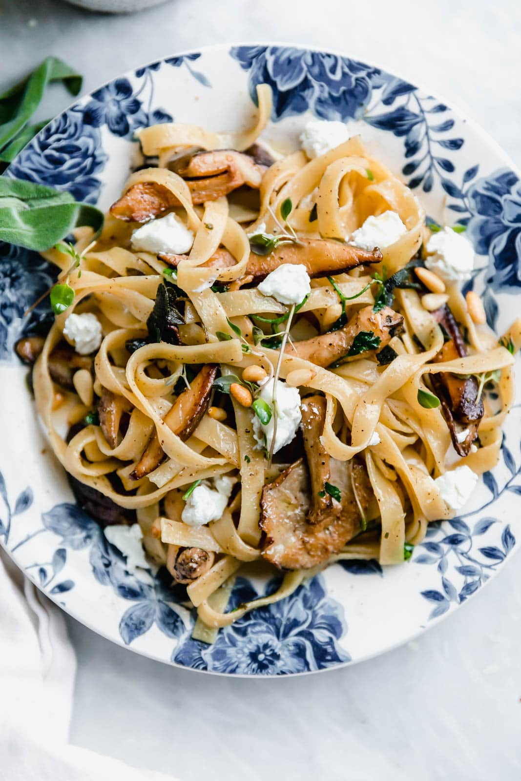 A hearty Herby Mushroom Tagliatelle flavored with brown butter sage shiitakes, toasted pinenuts, and goat cheese. Get in my belly. Stat.