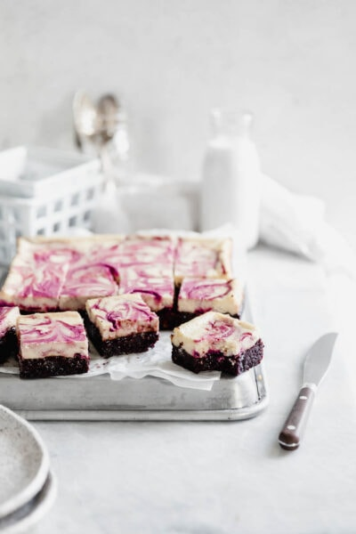 Black Cherry Cheesecake Brownies so rich and delicious you won't be able to stop at just one! Made with a black cherry swirl and fudgy brownie bottom.