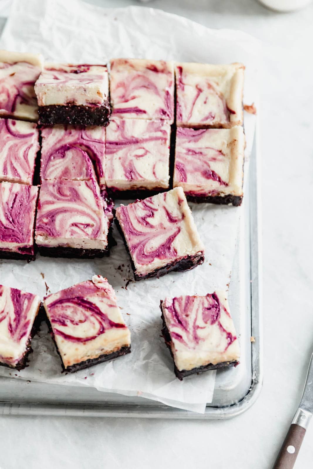 Rich fudge brownies topped with creamy cheesecake and a sinful black cherry swirl. Easy to make and even easier to devour.