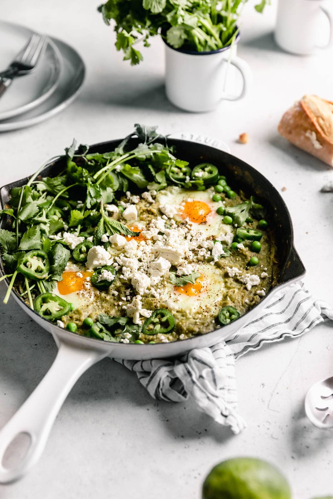 Green Shakshuka aka poached eggs cooked in a spiced green tomato sauce and topped with cilantro and feta. Talk about the best breakfast ever!
