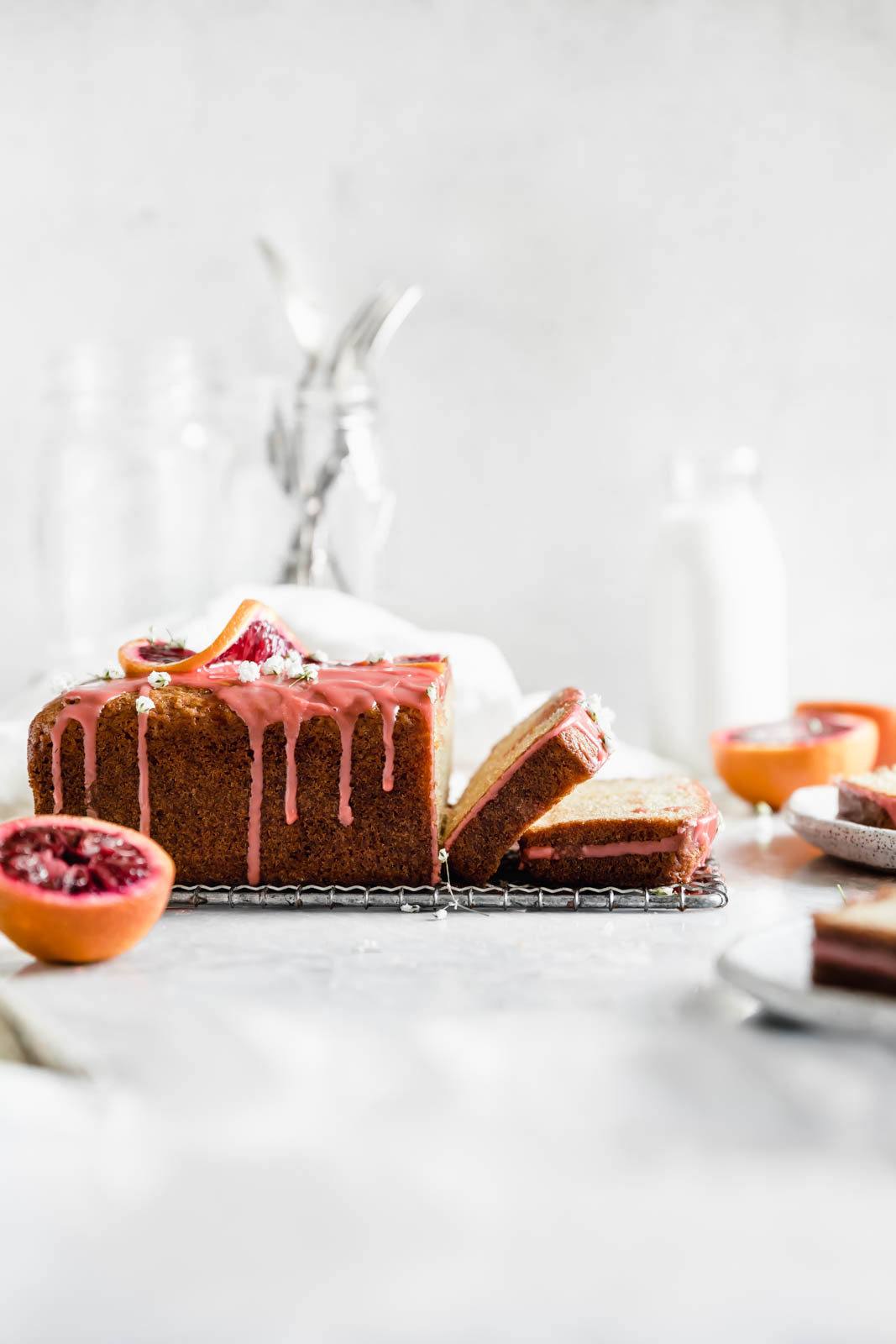Celebrate citrus season with this beautiful blood orange loaf cake made with greek yogurt and topped with the perfect tangy pink glaze.