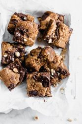 Brown Butter Nutella Chocolate Chip Cookie Bars with fat swirls of Nutella and lightly toasted hazelnuts. A salty sweet treat sure to be a showstopper.