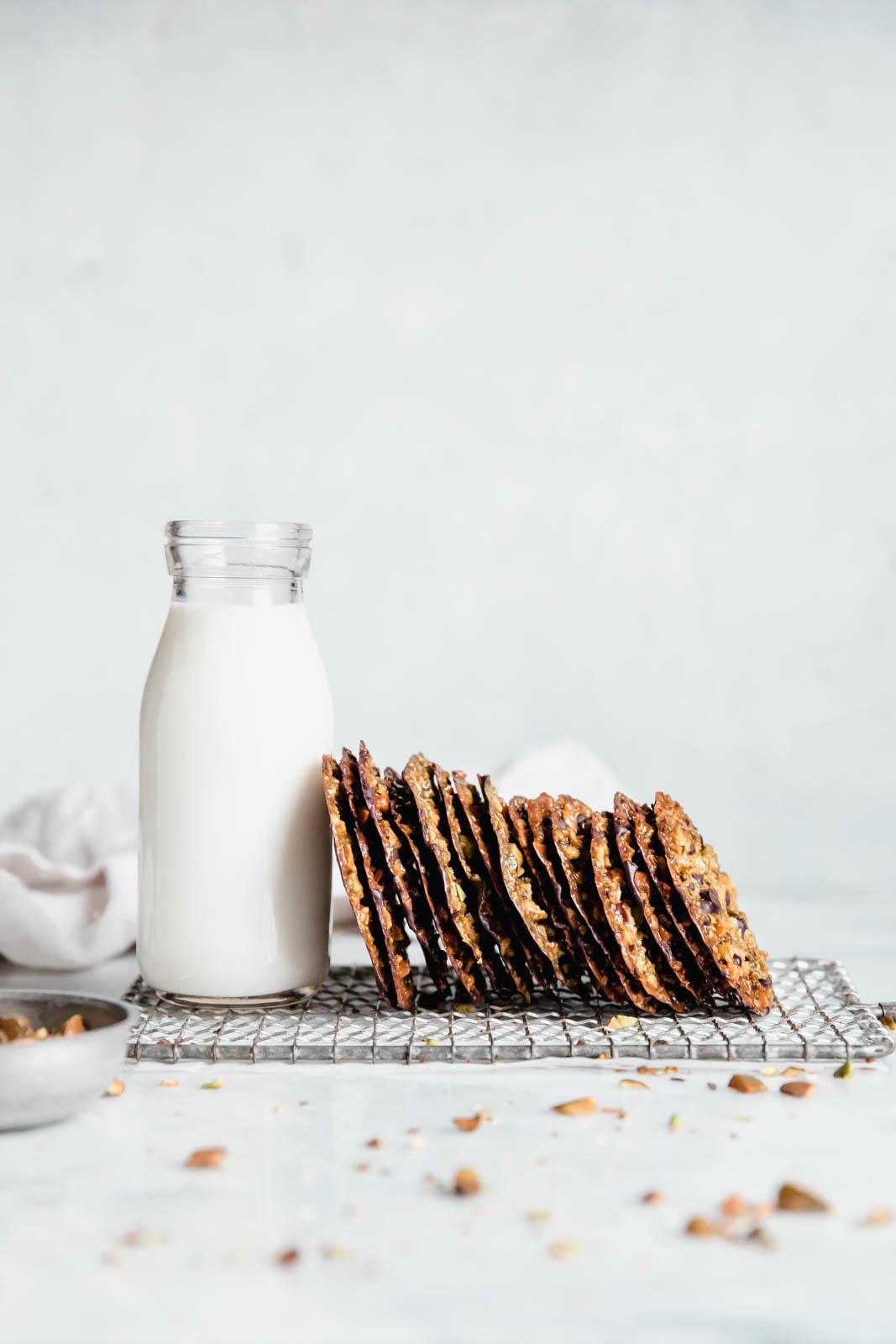 glass of milk with homemade lace cookies