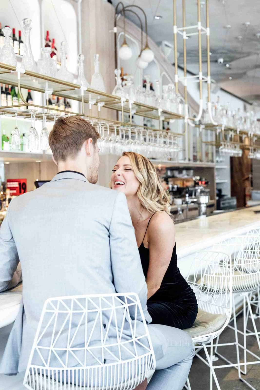 A modern and bright Restaurant Engagement Photo Shoot in downtown Toronto