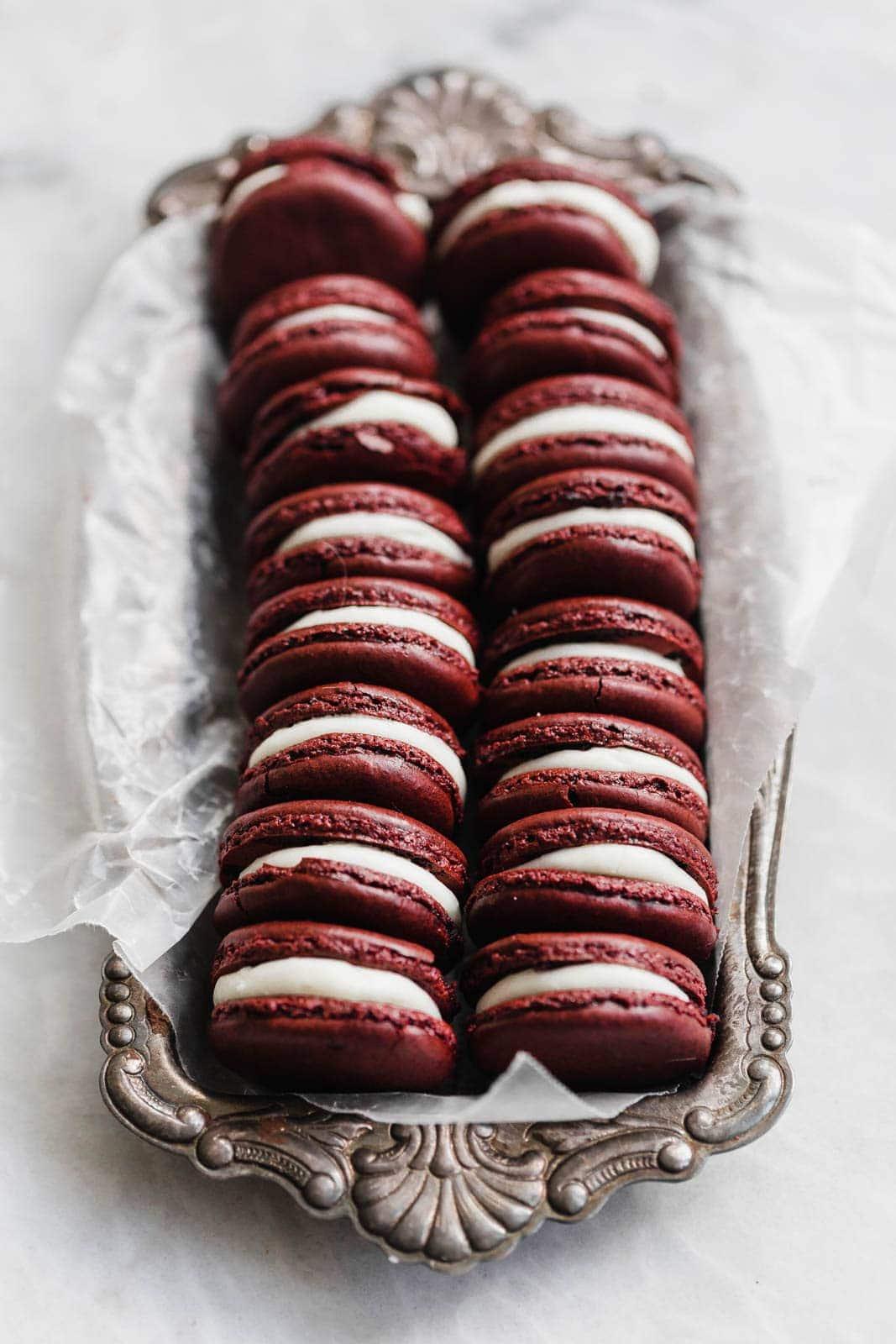 red velvet macarons in a tin