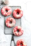 These baked strawberries and cream donuts are loaded wtih strawberries and dipped in fresh creamy glazeBetter yet, they're baked.