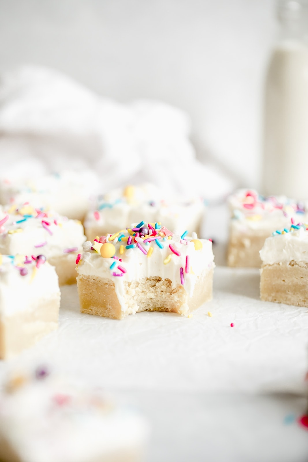 easy sugar cookie bars with frosting and sprinkles