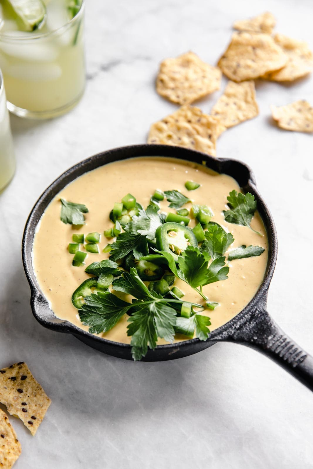 Creamy vegan queso made with cashews, nutritional yeast and smoky spice. Even the biggest cheese lovers will die over this easy vegan queso.