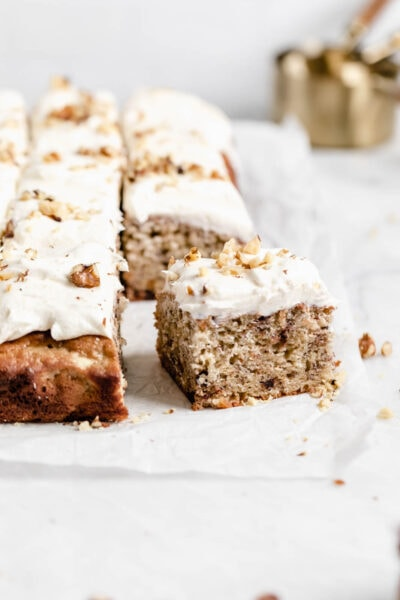 Brown butter banana chocolate chip sheet cake with cream cheese frosting has us drooling.Yum.