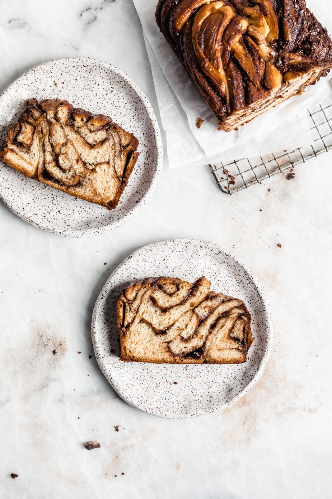 Buttery, flaky dough swirled together with cinnamon AND chocolate make this stunning Cinnamon Chocolate Babka. Step by step instructions on how to make the perfect babka!