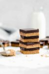 No bake healthy peanut butter chocolate bars made with just 4 ingredients! Vegan, gluten-free, and made with maple syrup, flax seed meal, & dark chocolate!