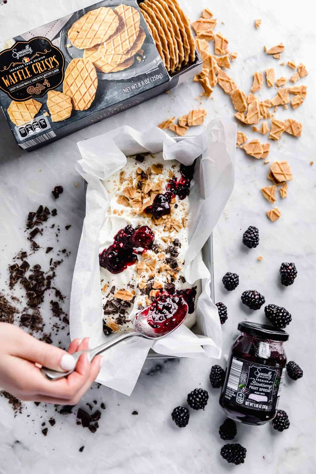 This creamy vanilla ice cream with fat blackberry swirls, buttery waffle pieces, and chocolate chips has us in heaven. Whip up this no churn blackberry waffle chocolate chip ice cream in minutes and skip the line at the ice cream shop.