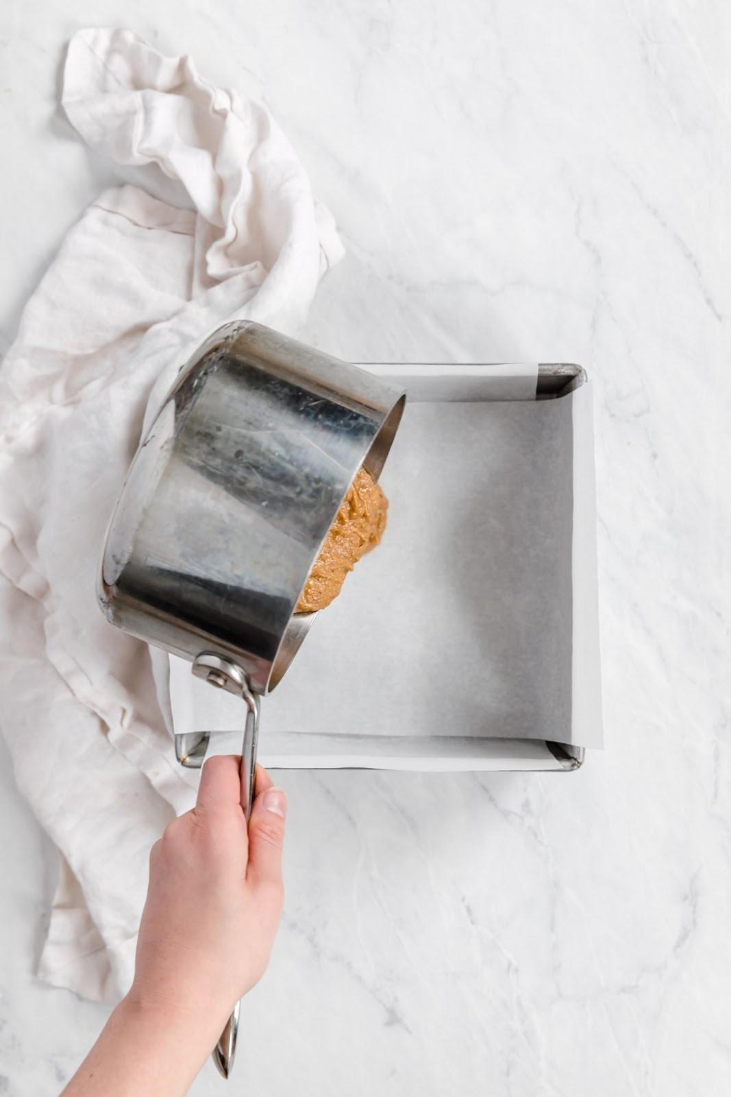 pour peanut butter mixture into pans