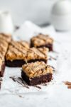 Samoas brownies AKA fudgy brownies topped with homemade coconut caramel sauce and drizzled with chocolate. Perfect for any Girl Scout cookie lover!