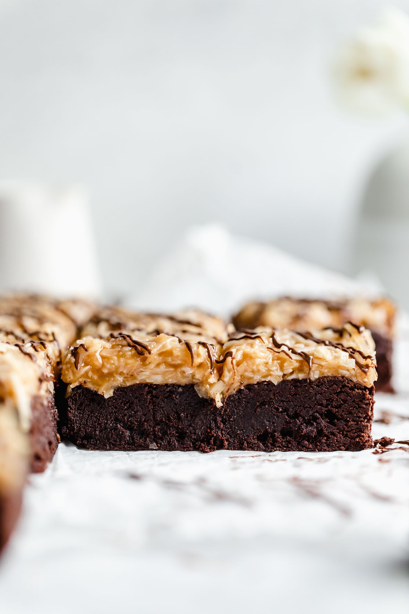 These Samoa brownies are fudgy brownies topped with homemade coconut caramel sauce and drizzled with chocolate. Perfect for any Girl Scout cookie lover!